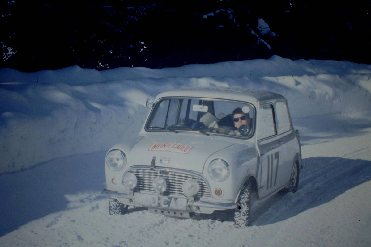 Mini Cooper driving through the snow.